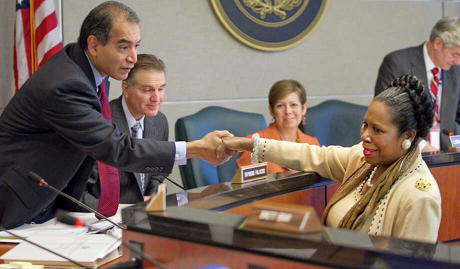 Rep. Sheila Jackson Lee congratulates Dept. of Motor Vehicles Board member Raymond Palacios after the board voted against the Confederate license plates, Nov. 10, 2011, in Austin. Photo: Ralph Barrera, Associated Press / Austin American-Statesman