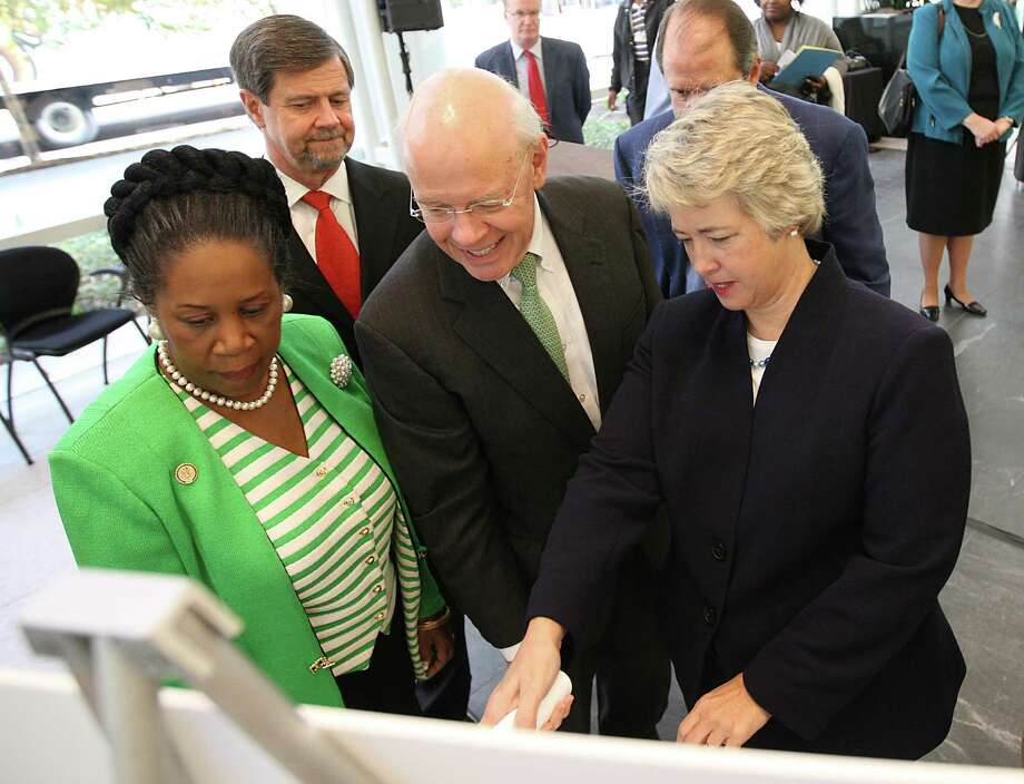 Mayor Annise Parker points out a location on a map detailing the GREENLINK bus route with Bob Eury, Executive Director of Houston Downtown Management District, and Congresswoman Sheila Jackson Lee in the lobby of BG Group Place in Houston on Oct. 10, 2011. Photo: Karen Warren, Houston Chronicle / © 2011 Houston Chronicle