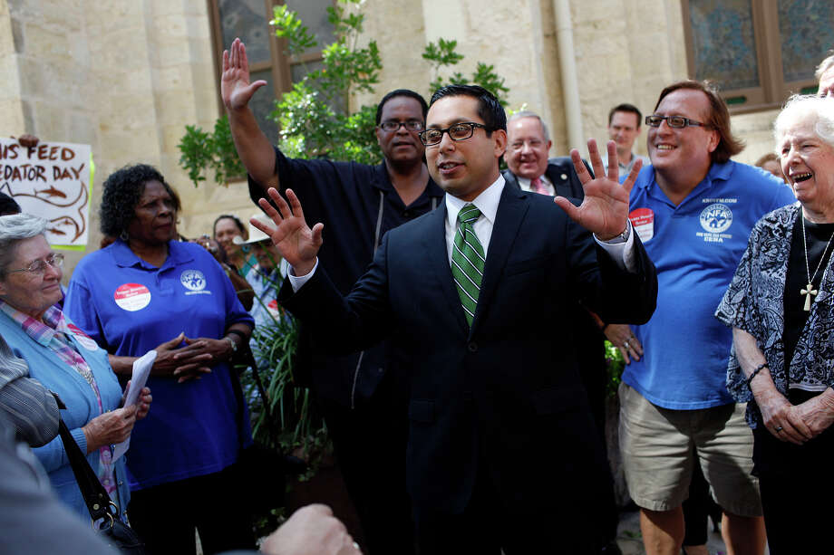 "Seniors chant ""Diego"" in support of City Councilman Diego Bernal, center, as he talks with them concerning the city ordinance he had drafted to regulate predatory lenders during the lunch break of the San Antonio City Council Meeting where the item is being discussed on Thursday, Sept. 20, 2012. Photo: LISA KRANTZ, San Antonio Express-News / © 2012 San Antonio Express-News"
