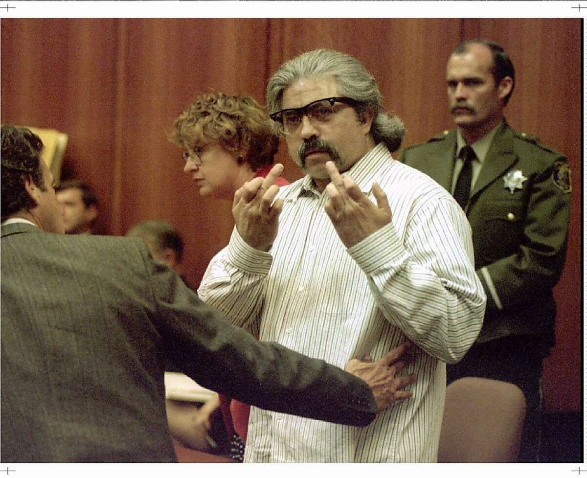 WAS98:CRIME-KLAAS:SAN JOSE,CALIFORNIA,5AUG96 - FILE PHOTO 18JUN96- Convicted murderer Richard Allen Davis is restrained by his lawyer Barry Collins (L) as he gestures in the courtroom after he was found guilty on all counts in the murder of Polly Klaas, in San Jose June 18. A California jury has recommended a sentence of death for Davis in the 1993 kidnapping and murder of Polly Klaas. ld/Pool Photo REUTERS