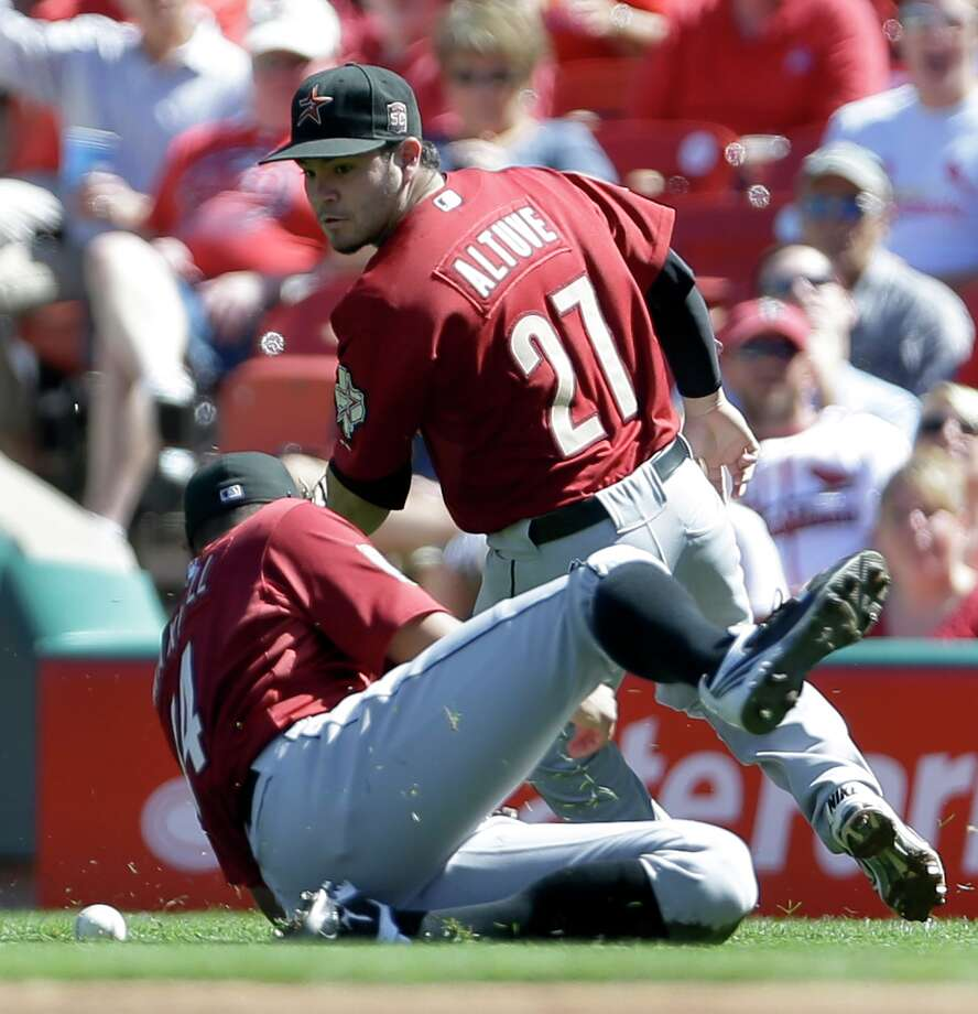 Sept. 20: Cardinals 5, Astros 4Right fielder Justin Maxwell, front, dives but misses a ball hit for a single by the Cardinals Matt Holliday as second baseman Jose Altuve watches during the first inning.Record: 48-102. Photo: Jeff Roberson