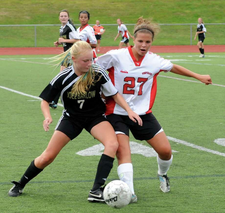 Joel Barlow High School's Jillian Marini and Pomperaug High School's Paige Foschi battle for possession of the ball during their soccer game at Pomperaug on Thursday, September 20, 2012. Photo: Lisa Weir / The News-Times Freelance