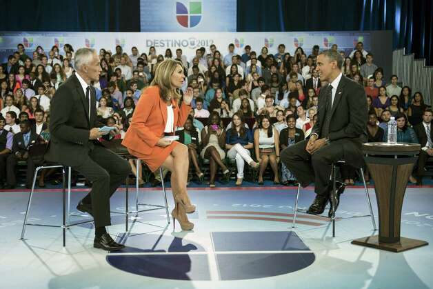 "Hosts Jorge Ramos (L) and Maria Elena Salinas (C) sit with US President Barack Obama during a break in a taping of Univision News's ""Meet the Candidates"" at the University of Miami September 20, 2012 in Coral Gables, Florida.  Obama is traveling to Florida for the day to participate in a taping for Univision in Miami before attending a campaign event in Tampa.  AFP PHOTO/Brendan SMIALOWSKIBRENDAN SMIALOWSKI/AFP/GettyImages Photo: BRENDAN SMIALOWSKI, AFP/Getty Images / 2012 Brendan Smialowski"