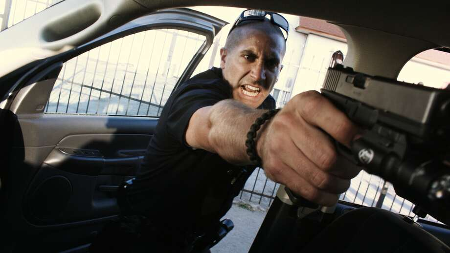 """End of Watch"" stars Jake Gyllenhaal as one of two young officers marked for death after confiscating a small cache of money and firearms from members of a notorious cartel during a routine traffic stop. Photo: Open Road Films"