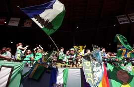 Portland Timbers fans cheer at a soccer match against the Seattle Sounders at Jeld-Wen Field, in Portland, Ore.