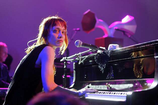 "FILE - This March 14, 2012 file photo shows Fiona Apple performing at the NPR showcase during the SXSW Music Festival in Austin, Texas. Apple has been arrested for hashish possession at a West Texas town after a Border Patrol drug-sniffing dog detected marijuana in her tour bus. Sierra Blanca Sheriff's office spokesman Rusty Flemming says the artist spent Wednesday, Sept. 19, at the Hudspeth County jail and would be bonded out Thursday. Fleming says Apple ""had a little tiny amount of pot and hash."" Fleming says marijuana possession in small amounts is a misdemeanor, while hashish in any quantity is a felony in Texas. (AP Photo/Jack Plunkett, file) Photo: Jack Plunkett"
