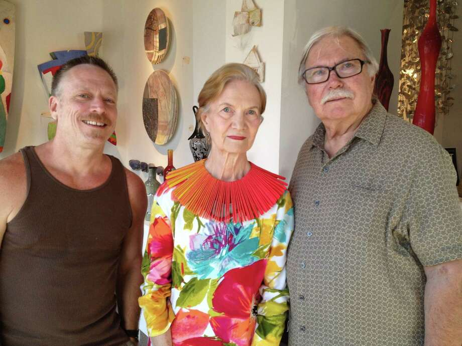 Artist Edward Lane McCartney, from left, works with dealers Oliver and Nancy Goldesberry (wearing a necklace by McCartney), who are retiring and closing their 21-year old Goldesberry Gallery at the end of the year. Photo: Molly Glentzer