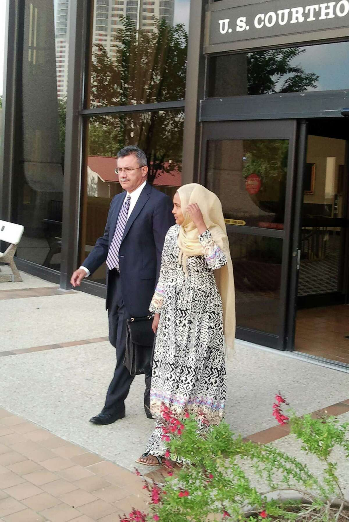 Deka Abdalla Sheikh leaves federal court in San Antonio with her lawyer, Javier Maldonado, after pleading guilty to lying.