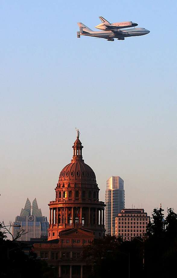 The space shuttle Endeavour passes over the capitol dome in Austin, Texas. Photo: Jay Godwin, Associated Press