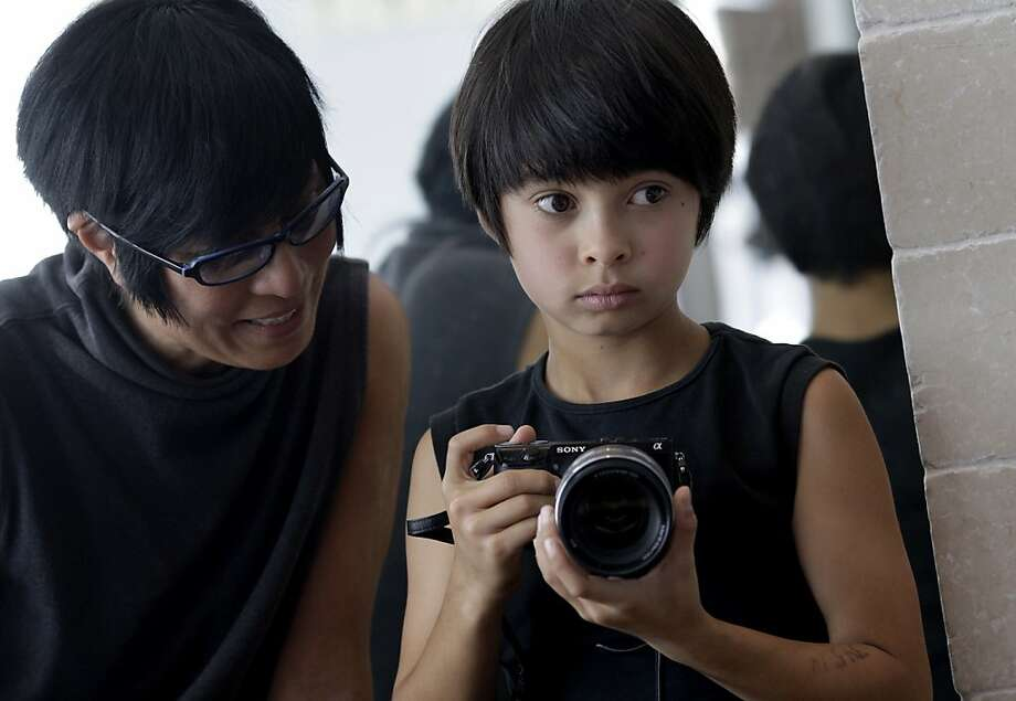 J.D. Beltran says her son Sebastien Bachar showed early talent, taking his first photo at age 2 of then-Mayor Gavin Newsom, below left. Photo: Brant Ward, The Chronicle