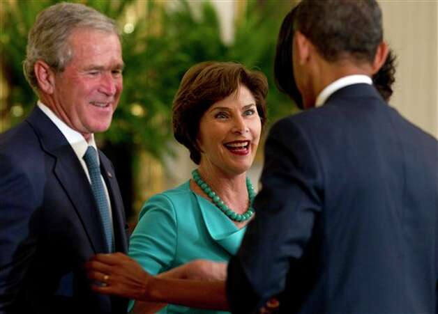 President Barack Obama greets former President George W. Bush and former first lady Laura Bush in the East Room of the White House in Washington, Thursday, May 31, 2012, during ceremony to unveil the Bush portraits. Photo: Carolyn Kaster, AP / AP