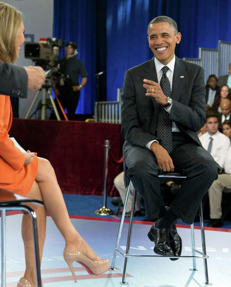 President Barack Obama participates in a town hall hosted by Univision and Univision news anchor Maria Elena Salinas, left, at the University of Miami, Thursday, Sept. 20, 2012, in Coral Gables, Fla.  (AP Photo/Carolyn Kaster) Photo: Carolyn Kaster / AP