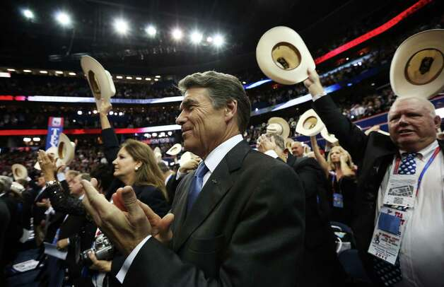 Texas Gov. Rick Perry applauds during the final day of the Republican National Convention at the Tampa Bay Times Forum on August 30, 2012 in Tampa, Florida. Former Massachusetts Gov. Mitt Romney was nominated as the Republican presidential candidate during the RNC which will conclude today. Photo: Win McNamee, Getty Images / 2012 Getty Images
