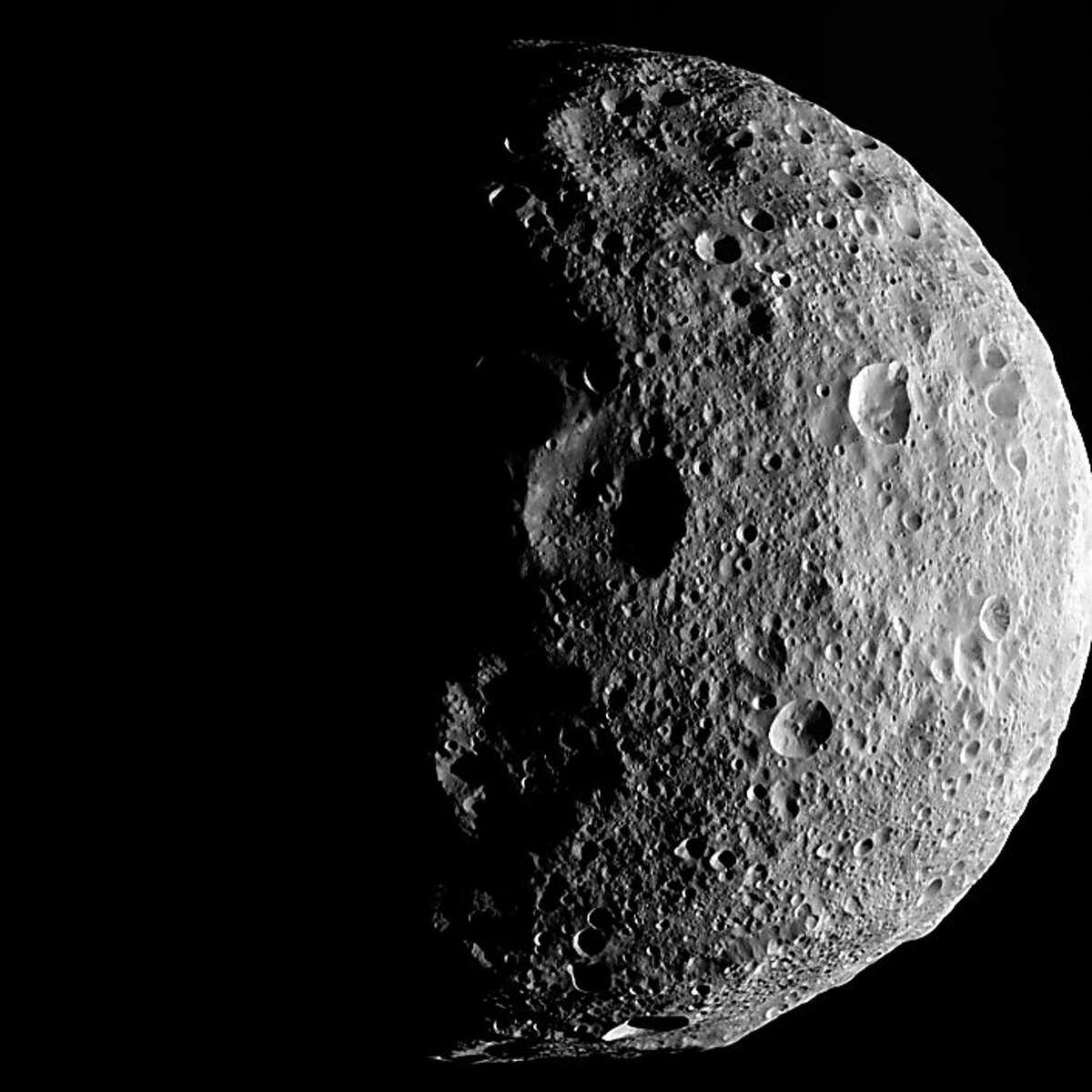"""This NASA image released September 5, 2012 shows the shadowy outlines of the terrain in Vesta's northern region in this image from NASA's Dawn spacecraft. The image comes from the last sequence of images Dawn obtained of the giant asteroid Vesta as it departed the giant asteroid. The view looks down at Vesta's north pole, which is in the middle of the image. When Dawn arrived in July 2011, Vesta's north pole was in darkness. After more than a year at Vesta, the sunlight has now made it to Vesta's north pole. AFP PHOTO/NASA / NASA/JPL-Caltech/UCLA/MPS/DLR/IDA = RESTRICTED TO EDITORIAL USE - MANDATORY CREDIT """" AFP PHOTO / NASA/JPL-Caltech/UCLA/MPS/DLR/IDA """" - NO MARKETING NO ADVERTISING CAMPAIGNS - DISTRIBUTED AS A SERVICE TO CLIENTS =HO/AFP/GettyImages"""