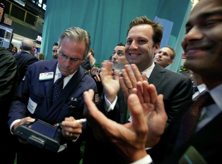 Trulia co-founder and CEO Pete Flint , center, and company CFO Sean Aggarwal, right, applaud as their stock has its initial public offering, on the floor of the New York Stock Exchange Thursday, Sept. 20, 2012. Trulia is an online marketplace for homebuyers, sellers, renters and real estate professionals. (AP Photo/Richard Drew) Photo: Richard Drew