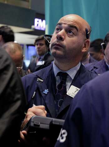 Trader Fred DeMarco works on the floor of the New York Stock Exchange Thursday, Sept. 20, 2012. Stocks are opening lower on Wall Street after the government reported that more people applied for unemployment benefits last week than economists had been expecting. (AP Photo/Richard Drew) Photo: Richard Drew