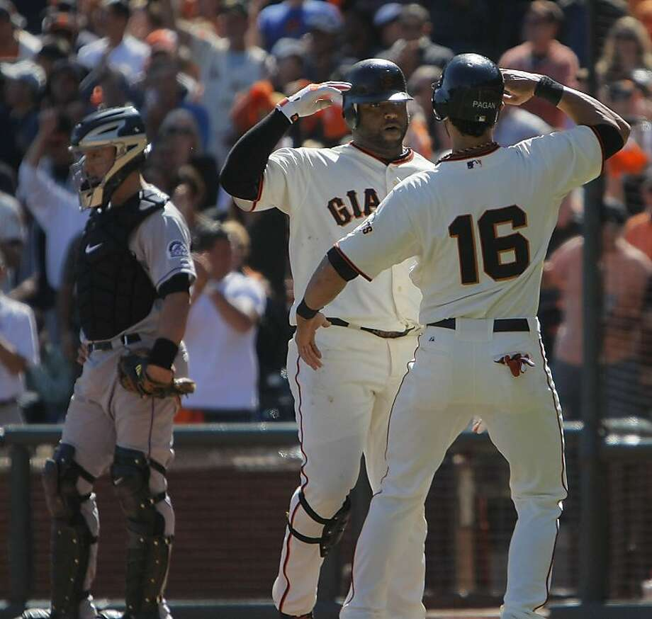 The Giants' Pablo Sandoval (l to r)  celebrates his homerun in the fourth inning with Angel Pagan after crossing home plate. The San Francisco Giants played the Colorado Rockies at AT&T Park  on Thursday,  September 20, 2012 in San Francisco, Calif. Final Score: San Francisco Giants: 9 - Colorado Rockies: 2 Photo: Lea Suzuki, The Chronicle