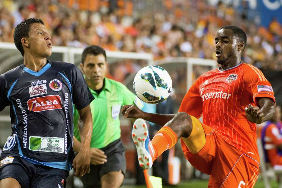 Houston Dynamo defender Warren Creavalle (5) controls the ball against C.D. FAS defender Ramon Flores during the first half of a CONCACAF Champions League match on Thursday, Sept. 20, 2012, at BBVA Compass Stadium in Houston. Photo: Smiley N. Pool, Houston Chronicle / © 2012  Houston Chronicle