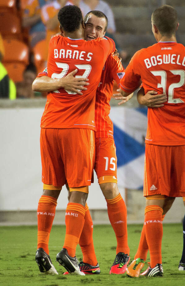 Houston Dynamo forward Cam Weaver (15) celebrates with midfielder Giles Barnes (23) after Barnes scored during the first half of a CONCACAF Champions League match against C.D. FAS on Thursday, Sept. 20, 2012, at BBVA Compass Stadium in Houston. Photo: Smiley N. Pool, Houston Chronicle / © 2012  Houston Chronicle