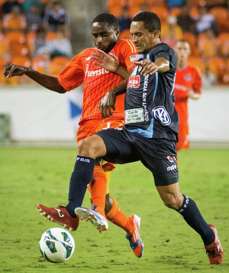 Houston Dynamo defender Warren Creavalle, left,  fights for the ball against C.D. FAS forward William Reyes during the first half of a CONCACAF Champions League match on Thursday, Sept. 20, 2012, at BBVA Compass Stadium in Houston. Photo: Smiley N. Pool, Houston Chronicle / © 2012  Houston Chronicle