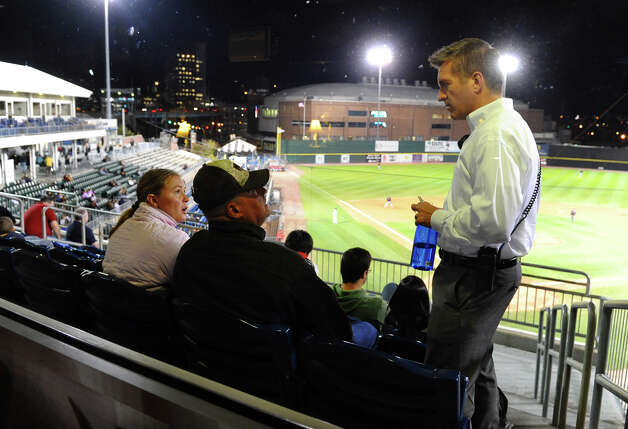 Bluefish baseball's new GM Ken Shepard, right, chats with fans David and Lillian Lewis, of Weston, during baseball action against Lancaster at the Ball Park at Harbor Yard in Bridgeport, Conn. on Thursday September 20, 2012. Photo: Christian Abraham / Connecticut Post