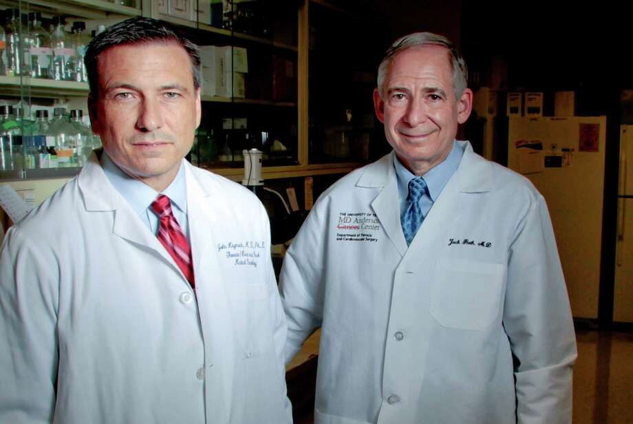 Dr. John Heymach, left, shown with M.D. Anderson's Dr. Jack Roth, is leading the lung Moon Shots Program. Photo: Billy Smith II / © 2012 Houston Chronicle