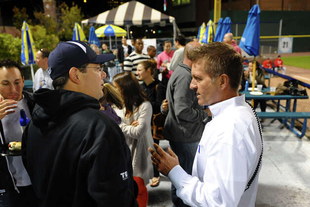 Bluefish baseball's new GM Ken Shepard, right, chats with fan Jason Pagano, of Monroe, during baseball action against Lancaster at the Ball Park at Harbor Yard in Bridgeport, Conn. on Thursday September 20, 2012. Photo: Christian Abraham / Connecticut Post