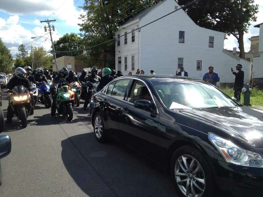 300 mourners packed Mount Pleasant Missionary Baptist Church and spilled out into the streets for the funeral of Alex H.V. Duncan, who was shot and killed on Ontario Street Sept. 13. The Jamaican-born Duncan was 35 years old. Bernard White, 23, was charged with second-degree murder and first-degree robbery in the killing. (Paul Grondahl / Times Union)
