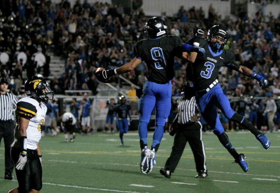 Clear Springs Byron Jones (9) celebrates a touchdown reception with teammate Devin Armstrong (3) during the first half of Eisenhower High school and Clear Springs High school match-up at Veterans in League City, Thursday September 20, 2012. Photo: Billy Smith II, Houston Chronicle / © 2012 Houston Chronicle