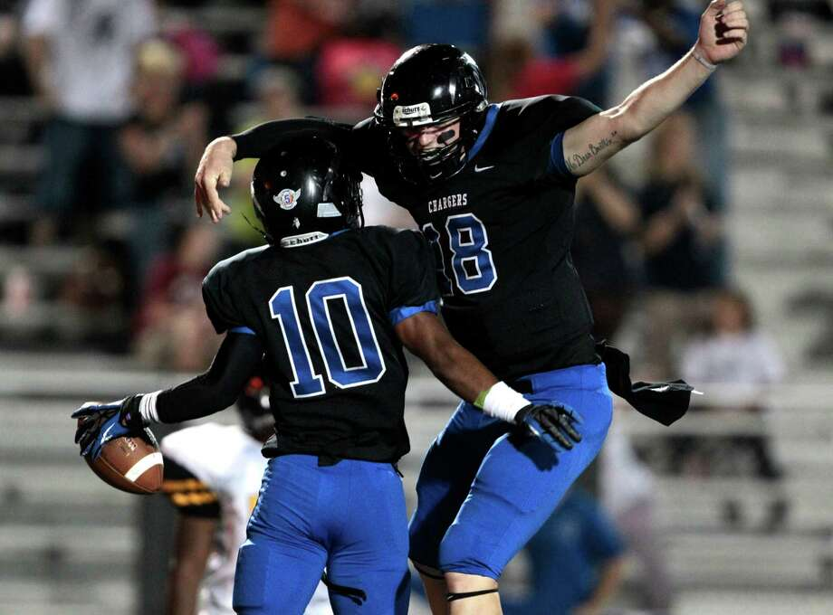 Clear Springs wideout Matt Guidry (10) celebrates a touchdown reception with his quarterback Zach Cripps (18) in the first half of there match- up with Eisenhower High school at Veterans in League City, Thursday September 20, 2012. Photo: Billy Smith II, Houston Chronicle / © 2012 Houston Chronicle