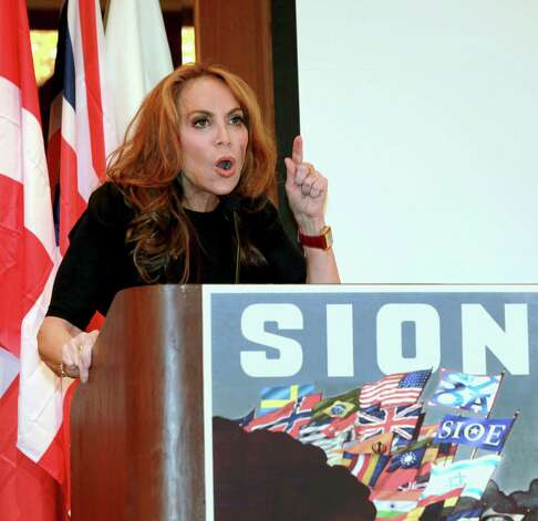 "In this Sept. 11, 2012 photo, anti-Islamic blogger Pamela Geller, speaks at a conference she organized entitled; ""Stop Islamization of America,"" in New York. An advertising campaign initiated by Geller's group, ""The American Freedom Defense Initiative,"" will have its ads that equate foes of Israel with ""savages"" appearing in 10 New York City subway stations after a federal judge ordered the Metropolitan Transportation Authority to put them up. (AP Photo/David Karp) Photo: David Karp"