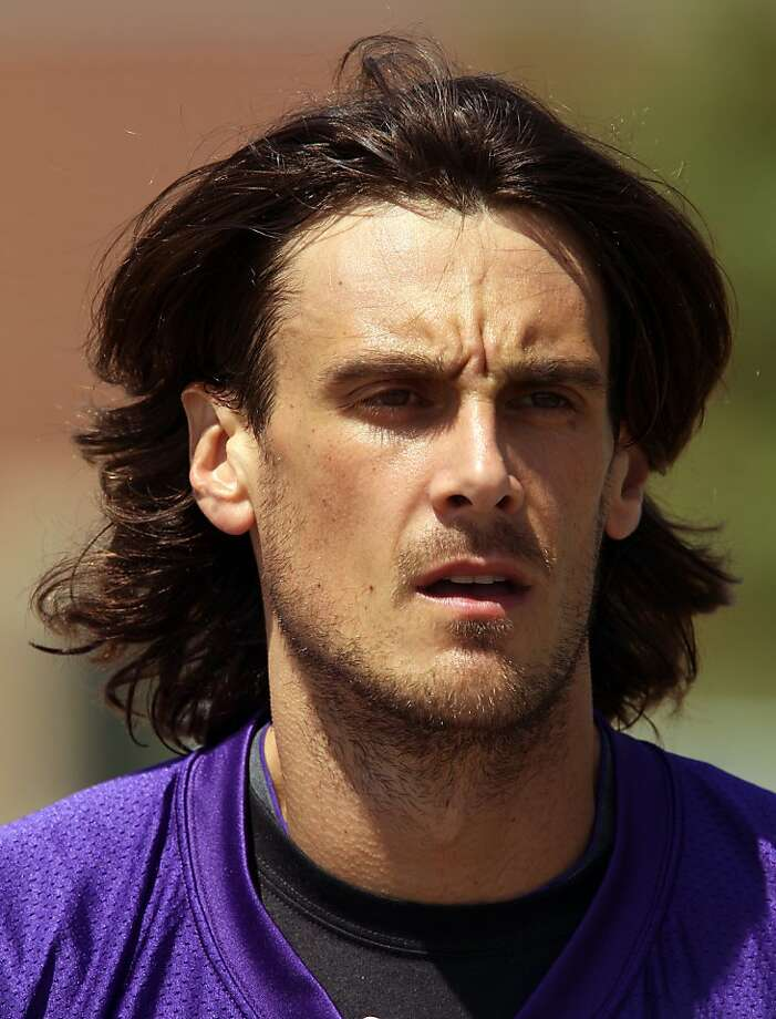 In this July 28, 2012 photo, Minnesota Vikings punter Chris Kluwe is shown at NFL football training camp in Mankato, Minn. NFL punters are only seen on fourth down, and heard from less than that. But with a constitutional gay marriage ban on Minnesota's ballot this fall, Kluwe has emerged as a high-profile gay rights champion _ and a symbol of changing attitudes toward homosexuality in the sports world. (AP Photo/Genevieve Ross) Photo: Genevieve Ross, Associated Press
