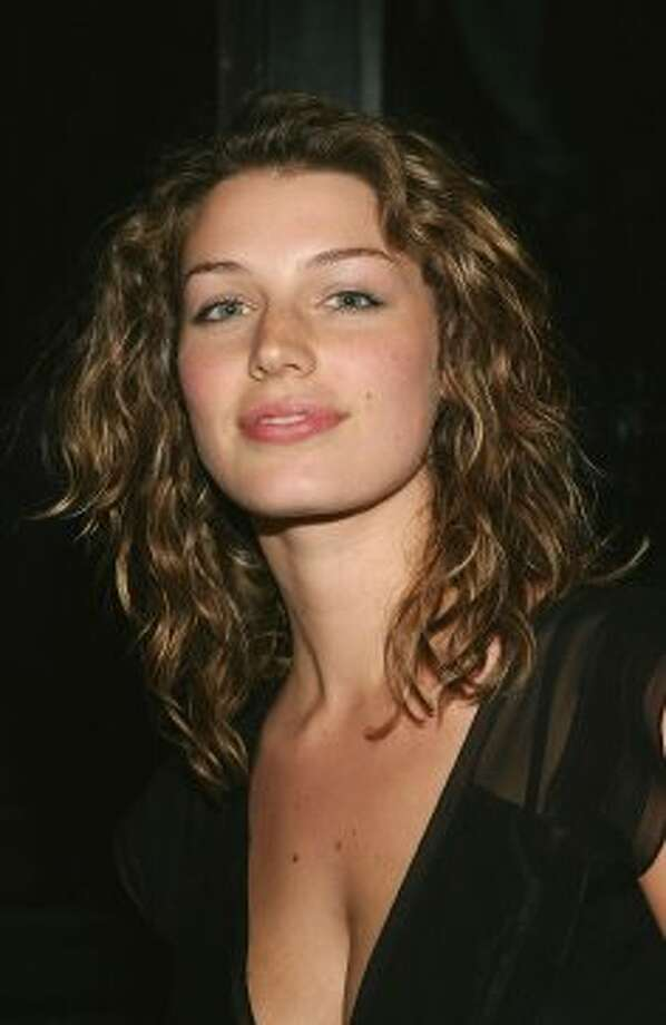 "Jessica Paré, 29, grew up in Montreal and speaks French, which probably helped her ""Zou Bisou Bisou"" performance. She's pictured in 2004 at a Calvin Klein underwear party.  (Getty Images)"
