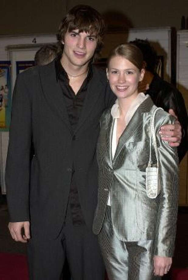 "Before January Jones, 34, started dating Josh Groban and playing Betty Draper, she dated Ashton Kutcher. They're pictured at the 2000 premiere of ""Dude, Where's my Car?""  (Getty Images)"