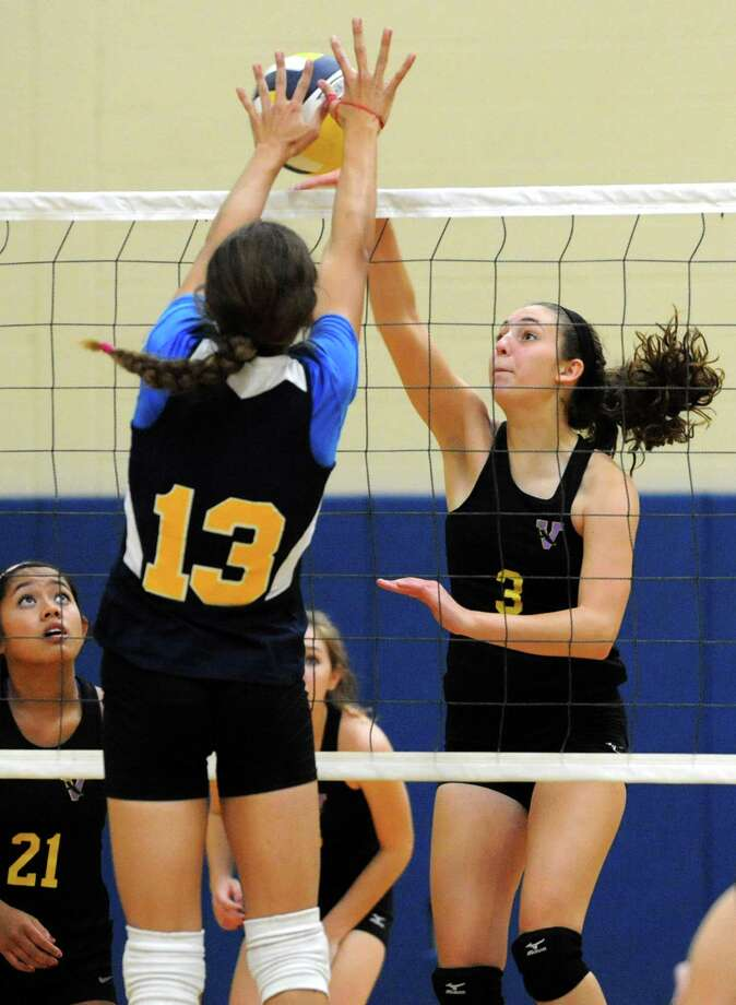 From left, Academy of the Holy Names' Kerry Losert and Voorheesville's Caroline Balin go hand to hand at the net during a volleyball match Thursday, Sept. 20, 2012 in Albany, N.Y. (Lori Van Buren / Times Union) Photo: Lori Van Buren