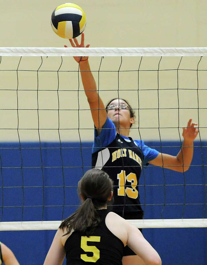 Academy of the Holy Names' Kerry Losert tips the ball over the net during a volleyball match against Voorheesville Thursday, Sept. 20, 2012 in Albany, N.Y. (Lori Van Buren / Times Union) Photo: Lori Van Buren