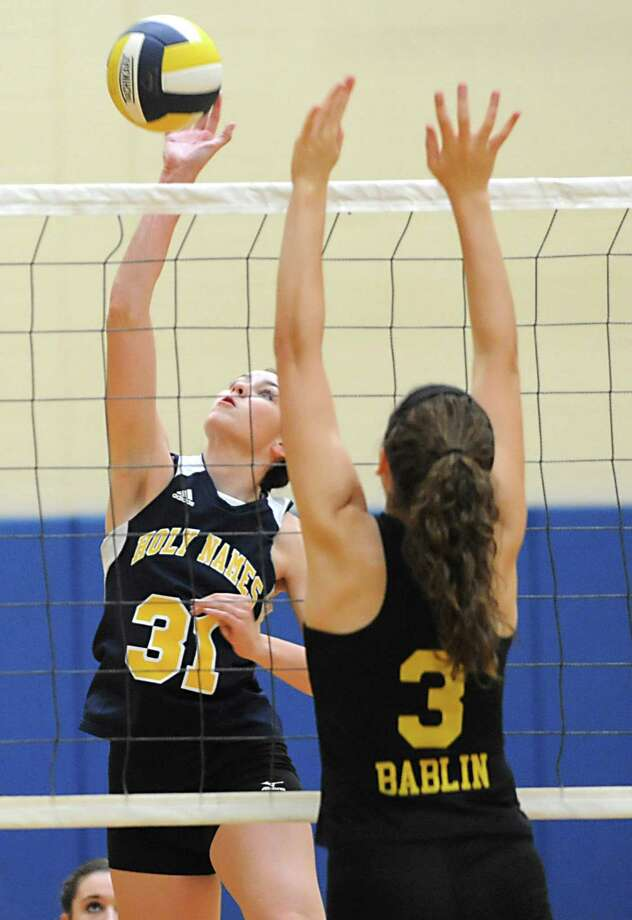 From left, Academy of the Holy Names' Megan Williams goes up against Voorheesville's Caroline Bablin at the net during a volleyball match Thursday, Sept. 20, 2012 in Albany, N.Y. (Lori Van Buren / Times Union) Photo: Lori Van Buren