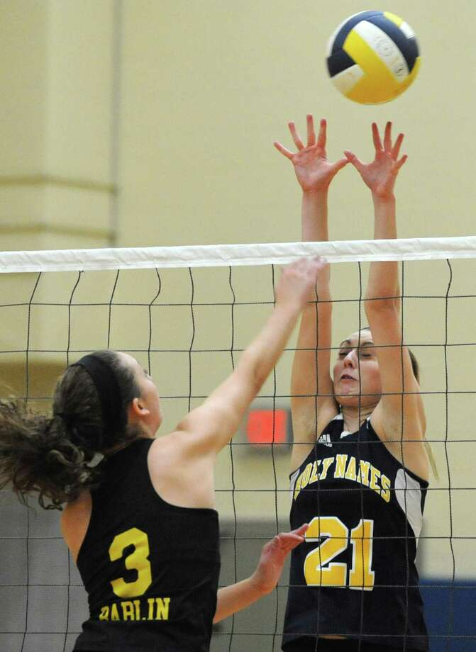 From left, Voorheesville's Caroline Bablin hits the ball past Academy of the Holy Names' Jen DuMond during a volleyball match Thursday, Sept. 20, 2012 in Albany, N.Y. (Lori Van Buren / Times Union) Photo: Lori Van Buren