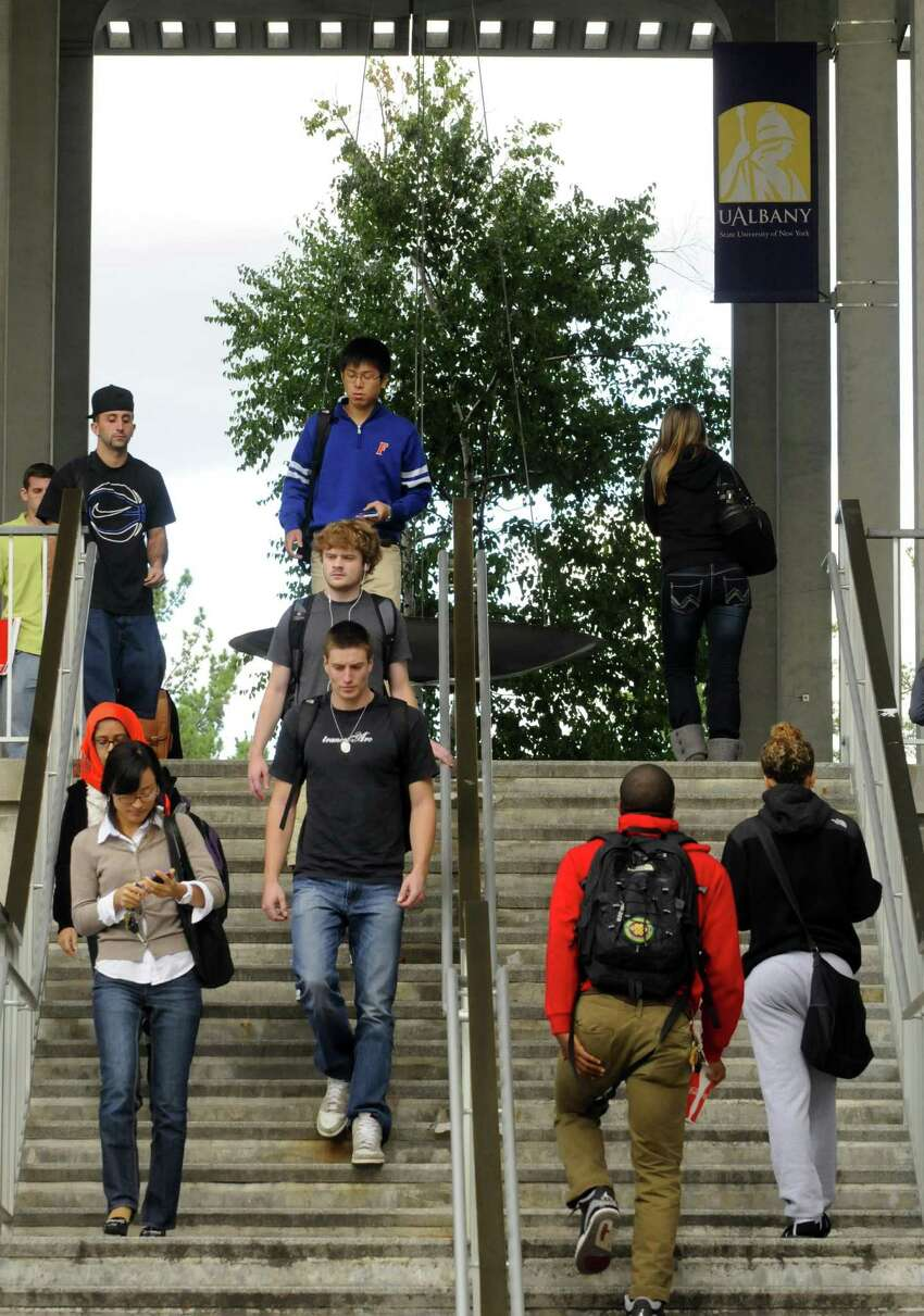 University at Albany students between classes on campus in Albany , NY Thursday Sept. 20, 2012. (Michael P. Farrell/Times Union)