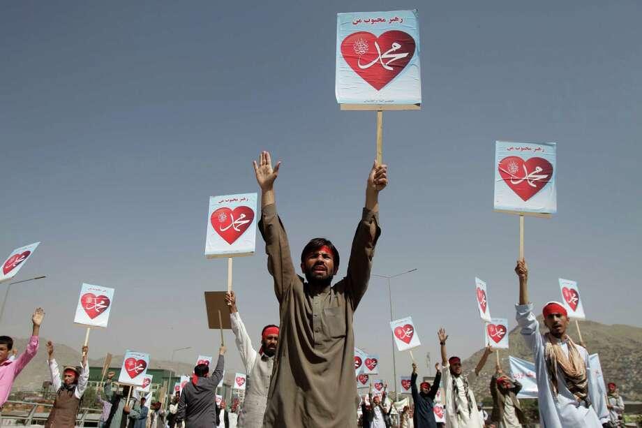 "Afghans hold placards reading: ""Our leader Mohammed"" during a protest against an anti-Islam film in Kabul, Afghanistan, Thursday, Sept. 20, 2012. (AP Photo/Ahmad Jamshid) Photo: Ahmad Jamshid"