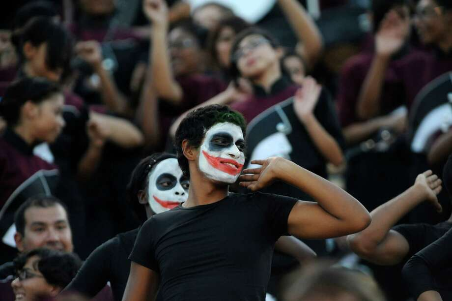 Members of the Highlands High School band and flag corps perform a routine in the stands during high-school football action at Alamo Stadium on Thursday, Sept. 20, 2012. Photo: Billy Calzada, Express-News / © San Antonio Express-News