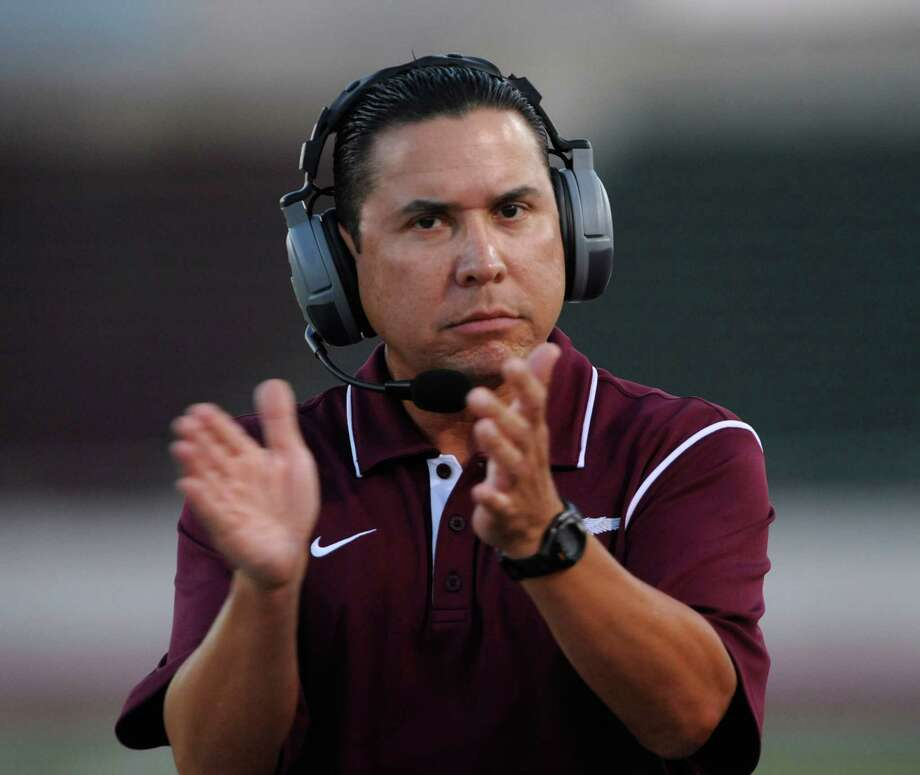 Highlands coach Bert Lopez applauds his team's effort against Central Catholic during high-school football action at Alamo Stadium on Thursday, Sept. 20, 2012. Photo: Billy Calzada, Express-News / © San Antonio Express-News