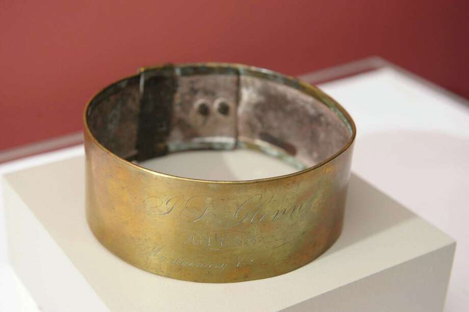 """A view of a slave collar c. 1806 at the New York State Museum in the new Civil War exhibit  on Wednesday, Sept. 19, 2012 in Albany, NY.  The collar is inscribed """"J.S. / Glenn / Montgomery Co NY"""".  The exhibit is entitled """"An Irrepressible Conflict: The Empire State in the Civil War"""".   (Paul Buckowski / Times Union) Photo: Paul Buckowski"""