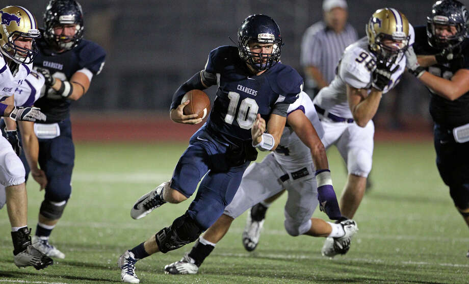 Kyle Poeske rolls for the Chargers as Champion hosts Marble Falls at Boerne Stadium on September 20, 2012. Photo: Tom Reel, Express-News / ©2012 San Antono Express-News