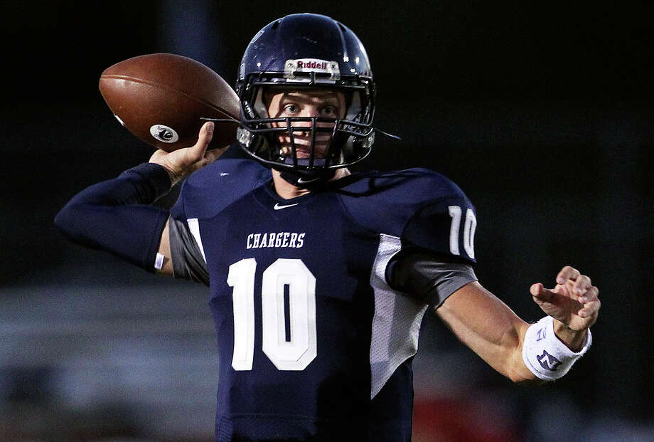 Kyle Poeske throws for the Chargers as Champion hosts Marble Falls at Boerne Stadium on September 20, 2012. Photo: Tom Reel, Express-News / ©2012 San Antono Express-News