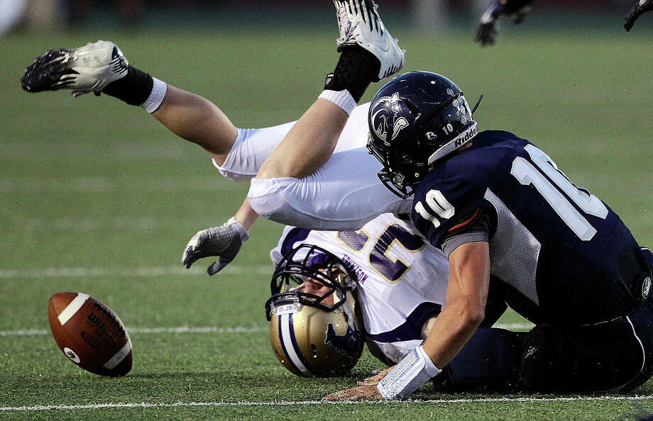 Charger Kyle Poeske (10)  fights for a loose ball with Cody Hunt as  Champion hosts Marble Falls at Boerne Stadium on September 20, 2012. Photo: Tom Reel, Express-News / ©2012 San Antono Express-News