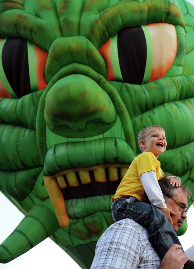 Braydon Matkowsky, 3, of Centerton, N.J. sits on the shoulders of his grandfather, Bill, during the Adirondack Balloon Festival on Thursday, Sept. 20, 2012, at Crandall Park in Glens Falls, N.Y. Bill Matkowsky, a balloon pilot, brought family to this year's festival even though he's taking time off from the activity. The festival continues through the weekend. (Cindy Schultz / Times Union) Photo: Cindy Schultz /  00019355A