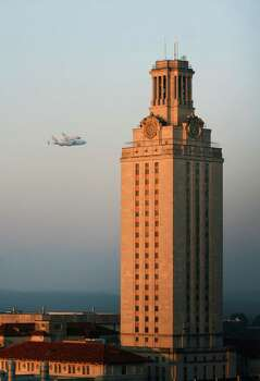 In this photo provided by the University of Texas, Space shuttle Endeavour sits atop the shuttle aircraft carrier, flies past the Tower at The University of Texas at Austin Thursday, Sept. 20, 2012. Endeavour is making a final trek across the country to the California Science Center in Los Angeles, where it will be permanently displayed. Photo: Lara Eakins, Associated Press / Lara Eakins The University of Te