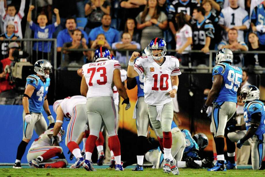 CHARLOTTE, NC - SEPTEMBER 20:  Eli Manning #10 of the New York Giants reacts after a touchdown against the Carolina Panthers during play at Bank of America Stadium on September 20, 2012 in Charlotte, North Carolina.  (Photo by Grant Halverson/Getty Images) Photo: Grant Halverson