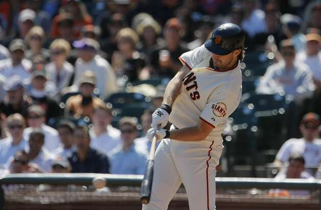 The Giants' Barry Zito swings at a pitch in the bottom of the third inning. The San Francisco Giants played the Colorado Rockies at AT&T Park  on Thursday,  September 20, 2012 in San Francisco, Calif. Final Score: San Francisco Giants: 9 - Colorado Rockies: 2 Photo: Lea Suzuki, The Chronicle